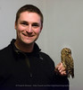 The photographer with a Scops Owl in captivity. The owl was brought in after it was found in Tromsø in October 2013, Norway