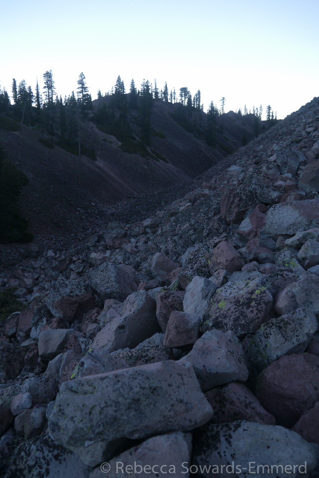 We're getting high enough to see some of the upper channels and piles that make up the craters and plugs of the summit.