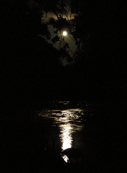 A full moon rises and reflects on Cache Creek