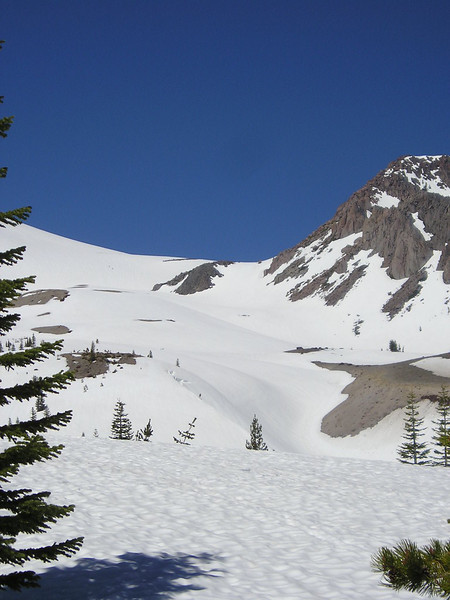 Skiiers<br /> <br /> they are the two dots to the left of the exposed rock in the middle of the photo.