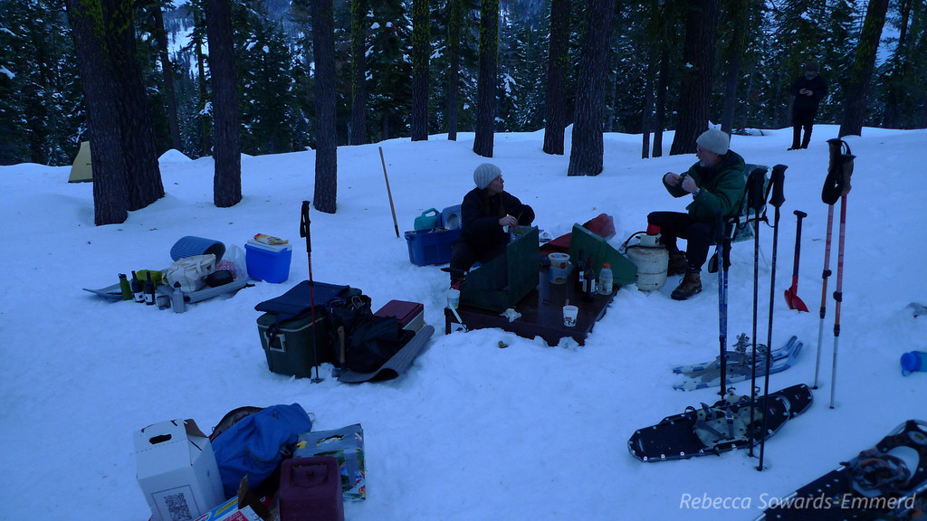 Sitting around in the snow - our kitchen is the top of the bear box that someone dug out.