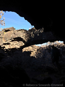 A small arch at the entrance to a cave.