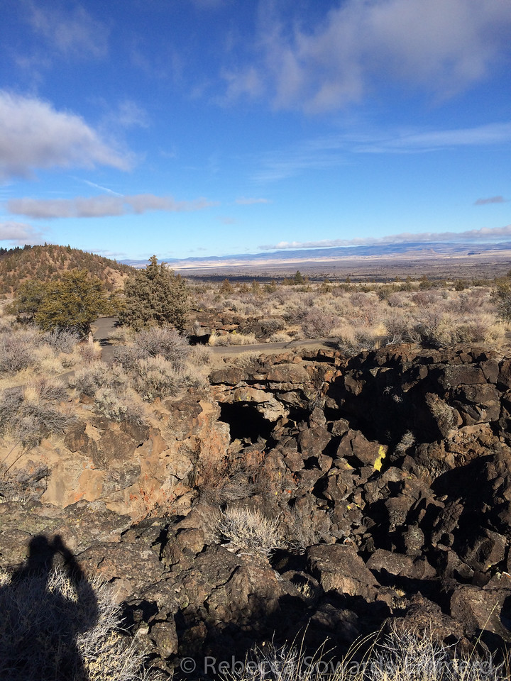 Above ground again, lava collapse and cave entrance visible.