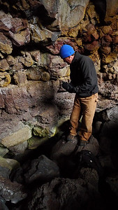 Greg above the cave entrance