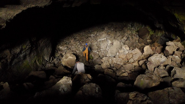 This cave is a deep hole where you have to climb down a steep slope of talus. Lights don't reach the bottom. Fun!