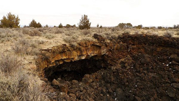 Look for these kind of collapses to find wild caves.