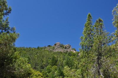 Then the trail meets an access road and the view open up - neat rock formations on the mountain come into view.