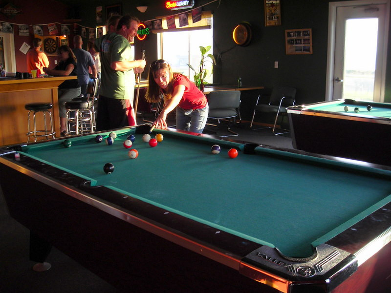 Paige plays pool in the bar at the Shelter Cove Golfcourse