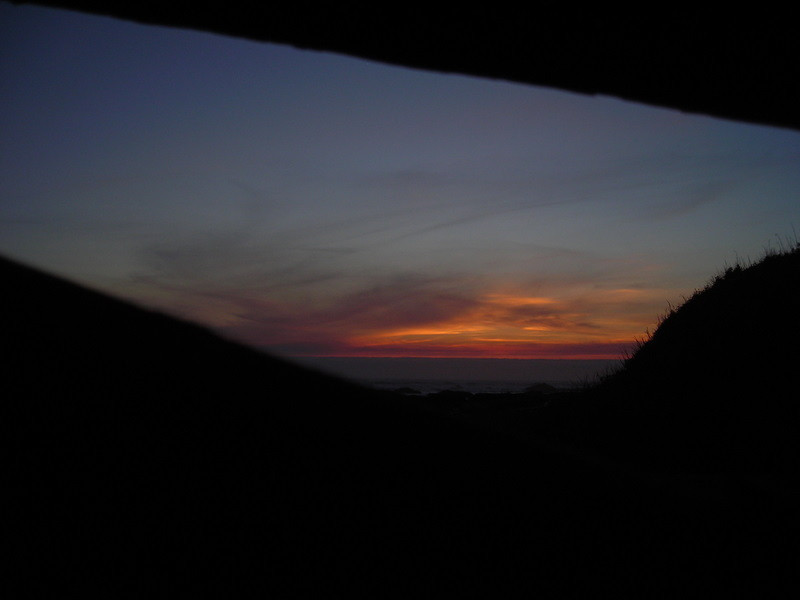 The final colors of sunset as viewed from inside the beach shelter