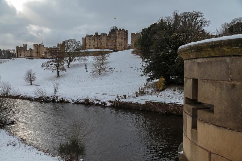 Alnwick Castle in snow from the bridge across the Aln
