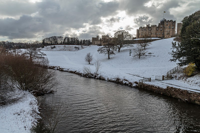 Alnwick Castle across the River Aln in snow