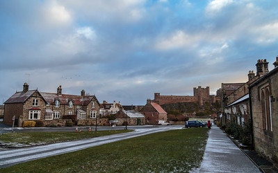 Bamburgh village with snowy view to castle