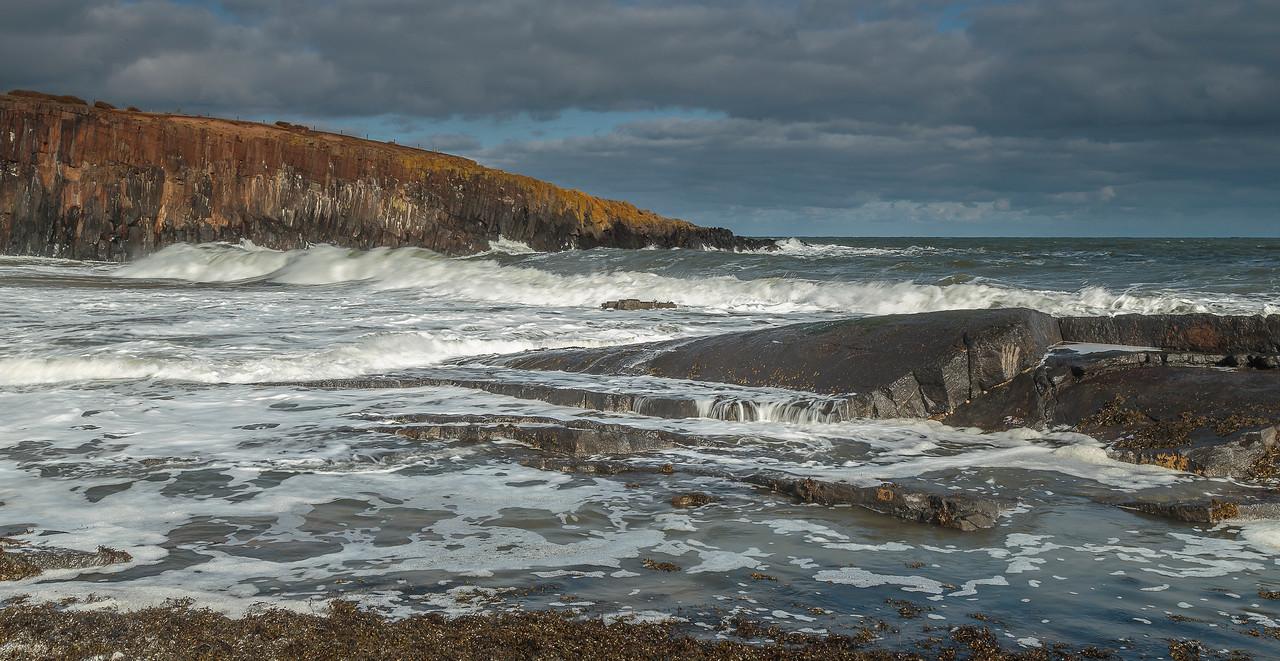 Cullernose Point - dramatic waves across basalt ledges