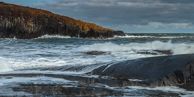 Cullernose Point - waves breaking on basalt ledges