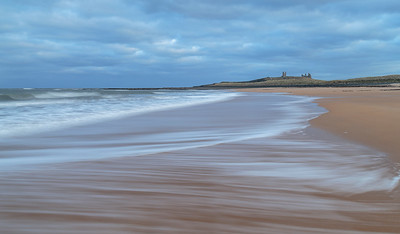 Dunstanburgh Castle seashore from Embleton Bay