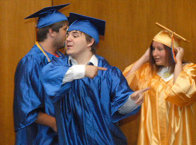 Line Mountain senior, Kevin Ray, directs a late friend to his spot in line before walking into their graduation Friday June 1, 2012.
