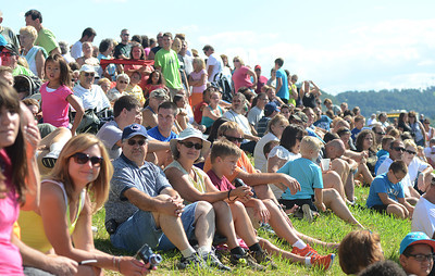 Crowds fill the river bank in Sunbury to watch the dozens of competitors race in the Cardboard Boat Regatta Saturday Aug. 18, 2012 during the Sunbury River Festival.