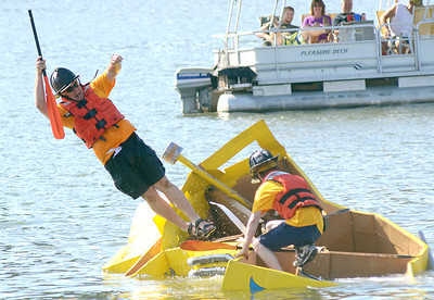 John Ferrari of Sunbury abandons ship as the East Sunbury Hose Company's cardboard boat finally sinks into the Susquehanna River Saturday Aug. 18, 2012 during the annual regatta in the Sunbury River Festival.