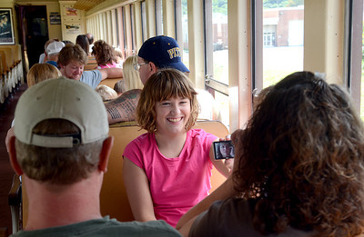 Grace Ahrens, 11, of Shamoking Dam shows off some funny photos before heading off on the historic train ride Saturday Aug. 18, 2012 during the Sunbury River Festival.