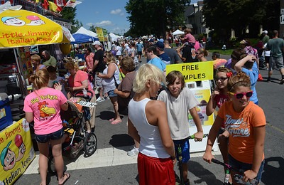 Thousands of people fill Front and Market Street Saturday Aug. 18, 2012 for the annual the Sunbury River Festival.