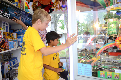 Jonathan Helfrick, 9, left, Elysburg, and Antonio Kantirot, 8, Paxinos, play a game on Monday afternoon at the All Homes Days in Elysburg.