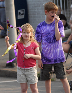 Megan, 7, and her brother, Daniel, 12, of Shamokin keep an eye out for candy during the parade Friday May 25, 2012 starting the Anthracite Heritage Festival of the Arts in Shamokin.