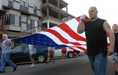 Paul Rider helps carry the American flag with the Brady Fire Company during the parade Friday May 25, 2012 to kick off the Anthracite Heritage Festival of the Arts in Shamokin.
