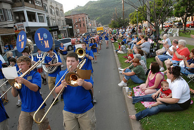 The Line Mountain High School marching band passes spectators along Market Street in Shamokin during the parade kicking of the annual Anthracite Heritage Festival of the Arts Friday May 25, 2012.