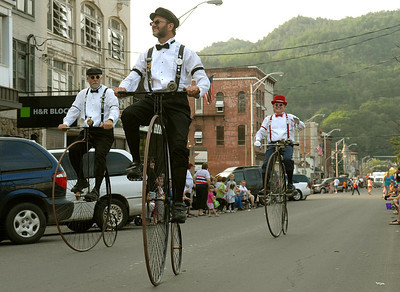 Members of Victorian Highwheelers out of Tamaqua, Pa cruise down Market Street in Shamokin during the Anthracite Heritage Festival of the Arts parade Friday May 25, 2012.