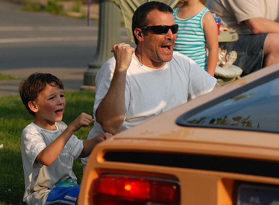 Jayden, 7, and his dad Jack McKeen of Coal Township yell for honks Friday May 25, 2012 during the Anthracite Heritage Frestival of the Arts' parade kicking off the two day event.