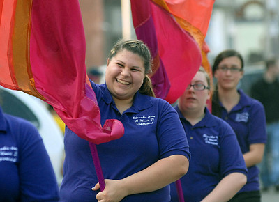 Katelyn Green joins member of the Shamokin Area High School flag team during the parade kicking of the annual Anthracite Heritage Frestival of the Arts Friday May 25, 2012.