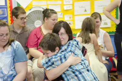 Benjamin Mack, 7, gives his mother Michelle, a hug at his kindergarten classes Authors Tea day on Thursday at Watsontown Elementary.