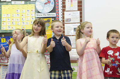 Watsontown Elementary kindergarten students Ava Henry, left, Ian Sanner, and Mallory Stover, sing a song during their classes Authors Tea day on Thursday.