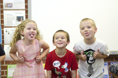 Watsontown Elementary kindergarten students Mallory Stover, Hayden Rodarte, and Luke Maturani, sing a song during their classes Authors Tea day on Thursday.