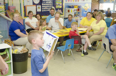 Watsontown Elementary kindergarten student Caden Snyder, 6, reads a page of a book that he wrote with his classmates on Thursday during a Authors Day tea.
