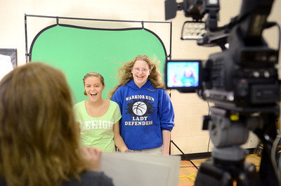 Warrior Run 8th grade students Maddie Beyer, 13, left, and Abbie Reed, 13, have fun at the CCN booth at the Milton High School career fair on Wednesday.