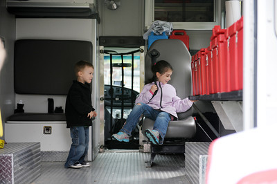 Oakley Landis, 2 of Limestoneville, and his sister Arabelle, 5, check out the inside of the American Red Cross disaster relief truck on Saturday morning at the Chery Blossom Festival and Touch A Truck event at the Milton Public Library at Rose Hill on Saturday morning.