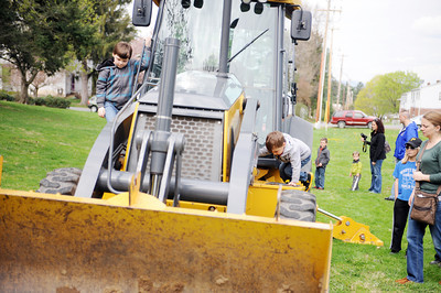 Caige Koch, 7 of Milton, and Bryson Walter, 3 of New Columbia, climb on a piece of contstruction equipment at the Cherry Blossom Festival and Touch a Truck event at the Milton Public Library at Rose Hill on Saturday morning.