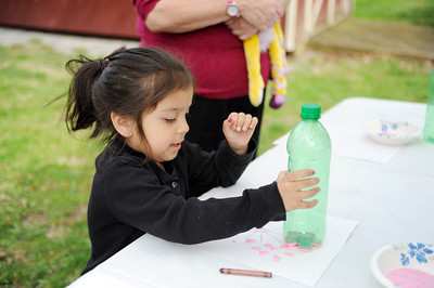 Rylie Tornes, 5 of Lewisburg, paints a picture of a cherry blossom tree at the Cherry Blossom Festival and Touch a Truck event at the Milton Public Library at Rose Hill on Saturday morning.