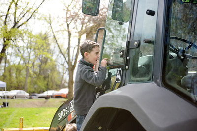 Lucas Shearer, 5 of Milton, looks inside a backhoe at the Cherry Blossom Festival and Touch a Truck event at the Milton Public Library at Rose Hill on Saturday morning.