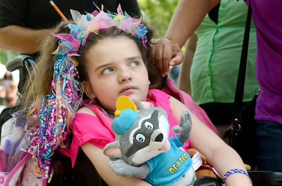 Ciara Conarty, 11, holds onto a Dexter stuffed animal at Knoebel's on Thursday where she was named queen for the day as part of the Make A Wish program.