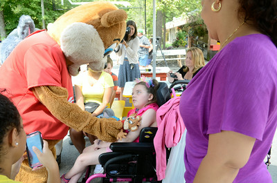 Kozmo gives Ciara Conarty, 11, a doll on Thursday at Knoebels where Ciara was named queen for the day as part of a Make A Wish program.