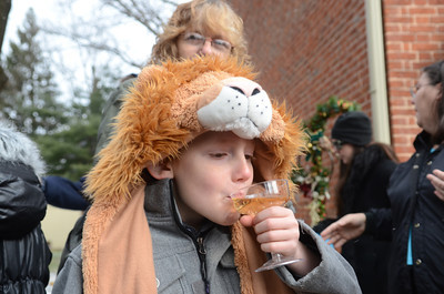Chase Long, 8, Northumberland, takes a sip of Ginger Ale outside the Priestly Library during their Countdown to Noon celebration for New Years on Tuesday.