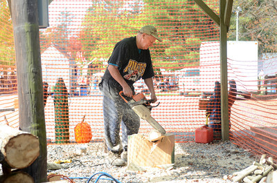 Donald Nilson, Danville, does a log carving with a chain saw on Thursday at the Covered Bridge Festival at Knoebels.