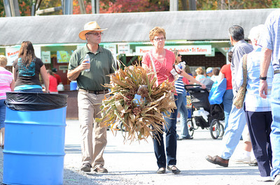 Bob and Joan Webre of Allentown carry their purchase through Knoebels on Thursday during the Covered Bridge Festival.