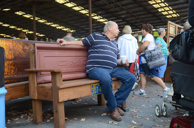 Chuck Everitt, Milton, takes a break from walking around the Covered Bridge Festival on Thursday at Knoebels.