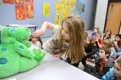 Chief Shikellamy second grade student Serenity Fry demonstrates proper brushing on Monday during a dental health demonstration put on by Geisinger Health Plan during Read Across America Week.