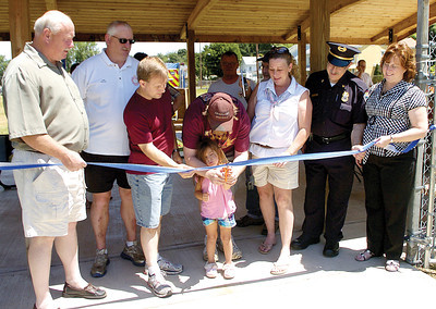 Sunbury councilman Jim Eister; Sunbury Fire Chief Mike Rhoads; Darrell Shaffer, organizer; Brain Thomas, volunteer;  Kaylee Gaustch, Little Miss Goodwill; Janice Corcoran, Playground Committee Member; Sunbury Police Chief Steve Mazzeo and State Rep. Lynda Schlegel Culver at the ribbon cutting for the Good Will Hose Company playground on Saturday afternoon.