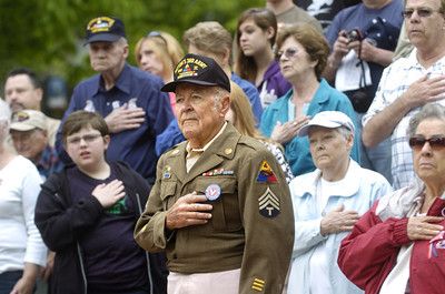 World War II Army veteran Bob Zimmerman Sr. holds his hand over his heart while the National Anthem was sung on Saturday morning in Cameron Park in Sunbury for a Hometown Veterans Celebration.