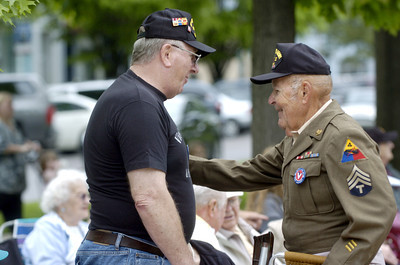 Vietnam Veteran Van Shipe, left, talks with WWII Veteran Bob Zimmerman Sr. at the Hometown Veterans Celebration on Saturday in Sunbury.